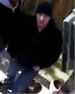 Suspect 2 is described as a white man wearing a black beanie style hat, black jacket and jeans