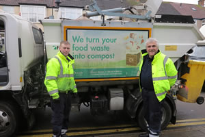 Leader of Merton Council, Councillor Stephen Alambritis helps with waste collection